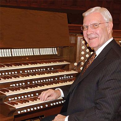 Fred Swann sitting at the organ.